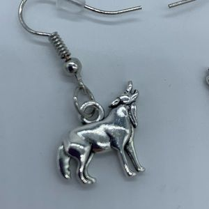 """Jewelry - New """"don't cry wolf"""" howling wolf fashion earrings"""